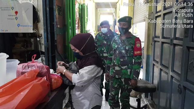 Tepatnya Dipasar Delima Indrapura Personel Jajaran Kodim 0208/Asahan Laksanakan Penegakan Disiplin Protokol Kesehatan
