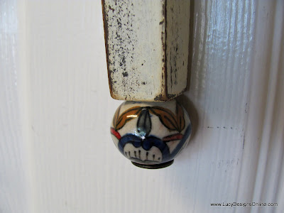 painted ceramic knob on tail of dragonfly