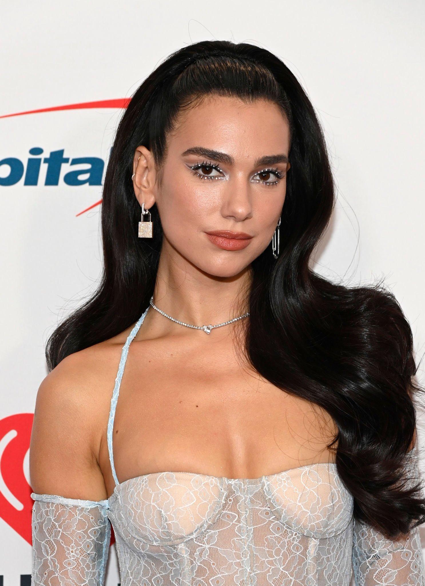Dua Lipa dazzles in lace catsuit at the iHeartRadio Music Festival 2021