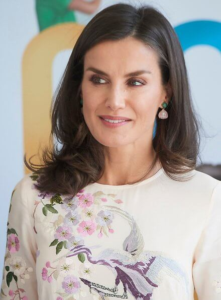 Queen Letizia wore a floral bird embroidery midi dress by Asos Design, and the Queen jewels Coolook Sarin diamond earrings