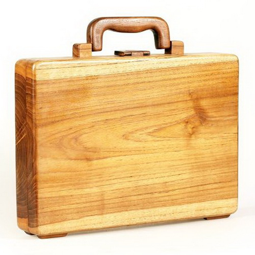 Tinuku Studio Sanoesa exhibiting sculpture luggage bags from sheets teak trees without splice