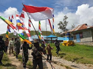 Menumbuhkan Rasa Nasionalisme Pemuda Papua, Satgas TNI Yonif 751 Mengajak Warga Meriahkan HUT RI ke-76