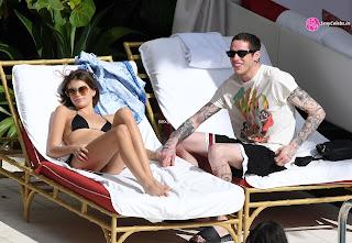 Kaia Gerber in tiny wet black bikini tongue kissing Pete Davidson in Miami Beach Pool Celebs.in Exclusive 052