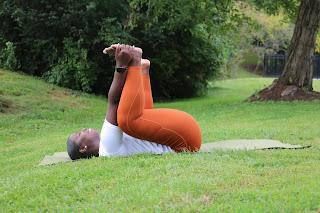 Tikima Renee Fitness in Happy Baby Pose
