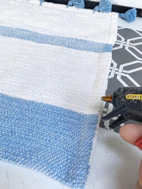 gluing the edges of the ipad bag