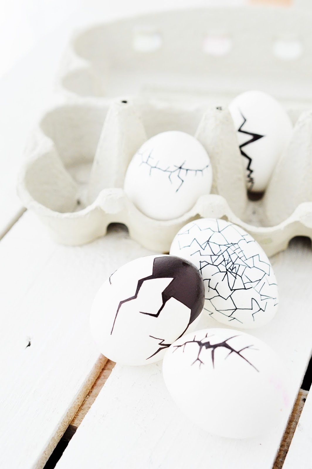 a bunch of Easter eggs painted with cracks