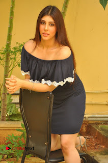 Actress Aditi Singh Pictures in Black Short Dress at tur Talkies 2 Movie Opening  0069