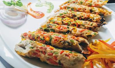 Serving garnished Seekh Kebab for chicken Gilafi Seekh Kebab recipe