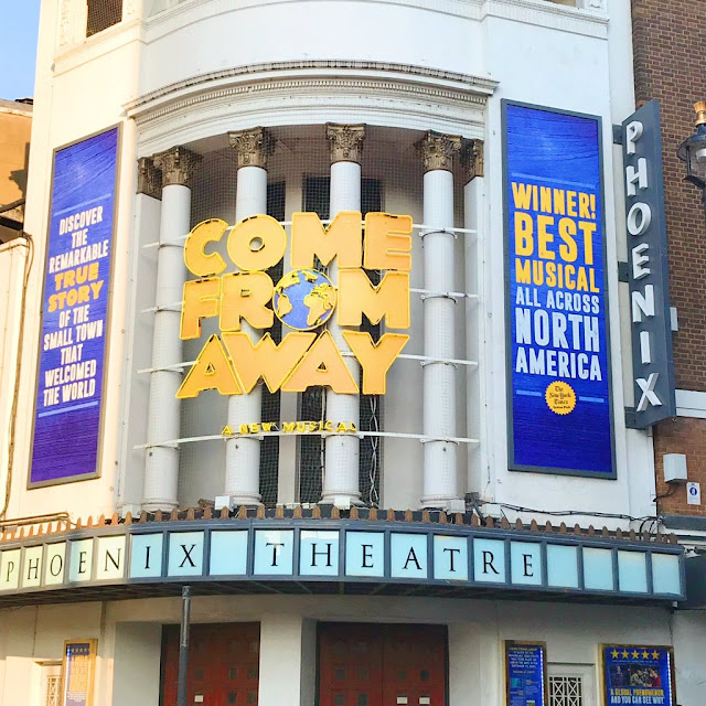 outside of the phoenix theatre, come from away sign