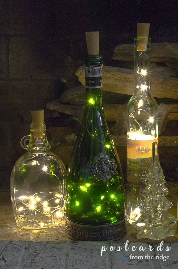 various bottles with lights inside a fireplace