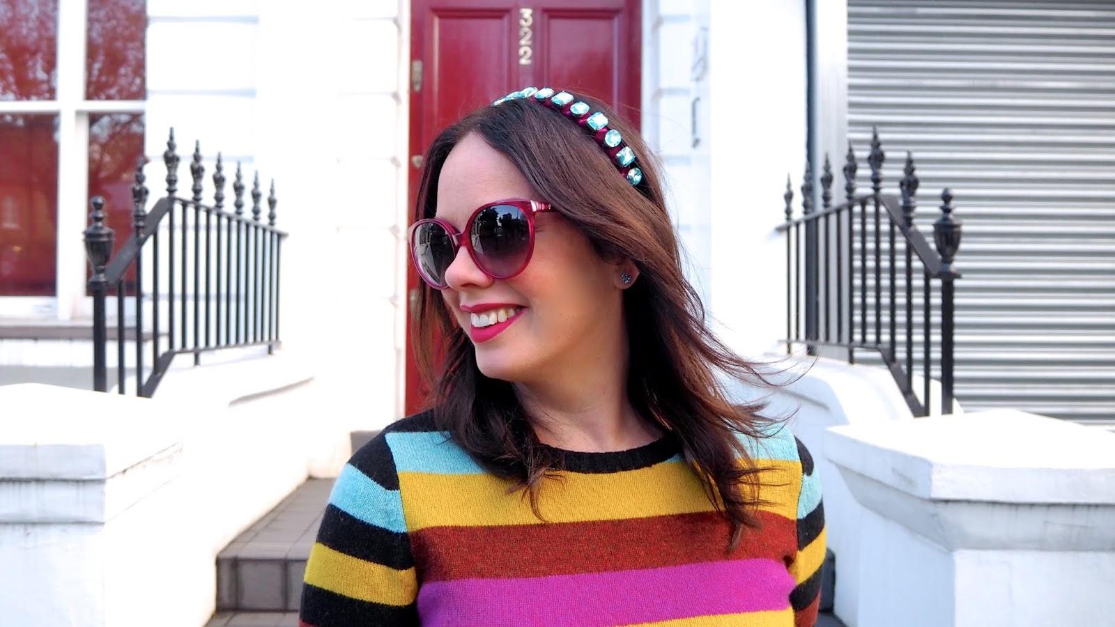 rainbow sweater and blue jewelled headband