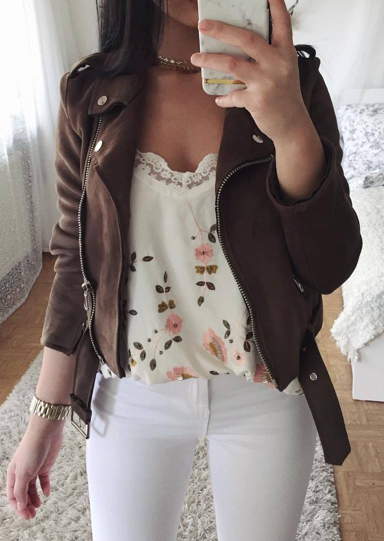 how to wear a brown biker jacket : floral top + white skinnies