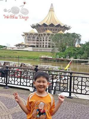 Henry at Kuching Waterfront with Dewan Undangan Negeri in the background