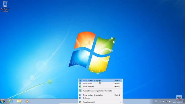 ahora si quieres quitar e modo pantalla completa en VirtualBox solo debes bajar el puntero te mostrará unas opciones y das clic en modo pantalla completa