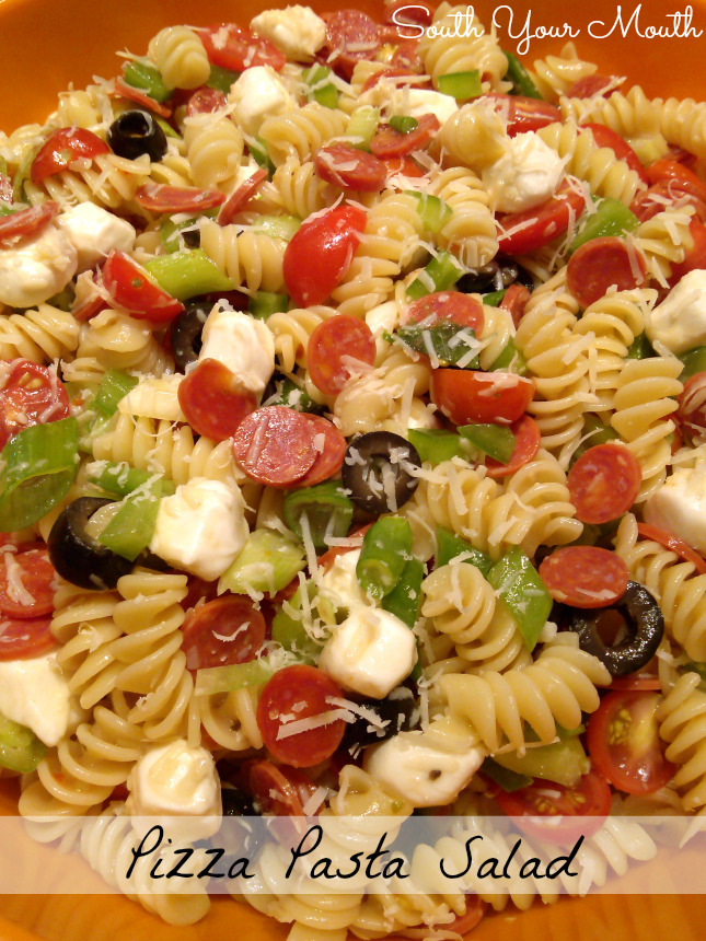 Pizza Pasta Salad made with mozzarella pearls, Italian dressing, mini pepperoni and all your favorite pizza toppings.