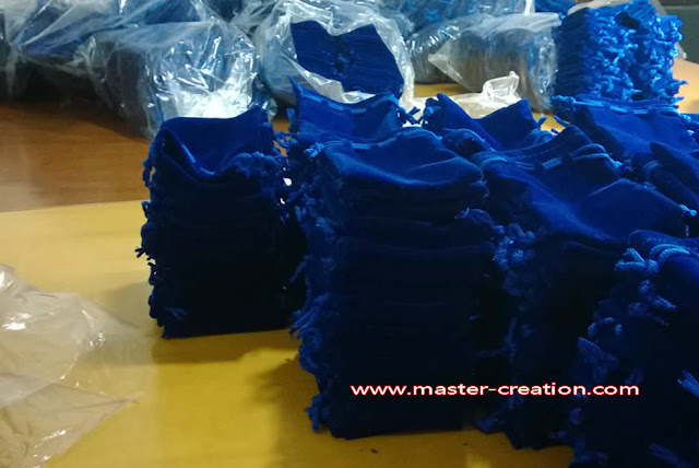 navy blue velvet bag inspection
