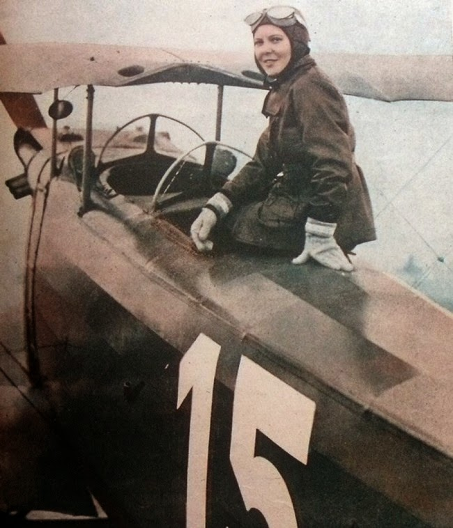 52 photos of women who changed history forever - Sabiha Gökçen of Turkey poses with her plane, in 1937 she became the first female fighter pilot.