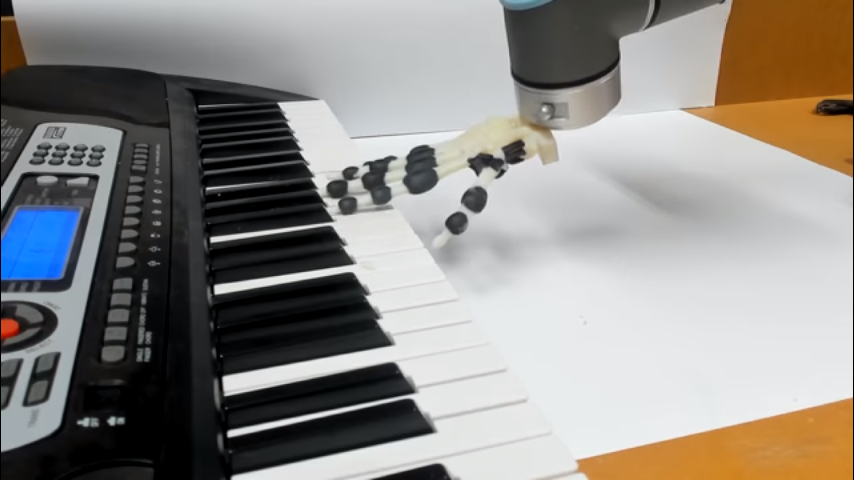 Robotic hand playing keyboard