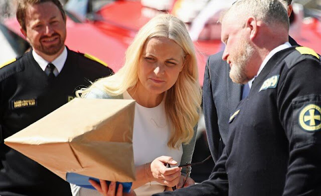 Crown Princess Mette-Marit wore nude eloise flats by Christian Louboutin. Maria La Rosa green clutch. Saint Laurent sunglasses