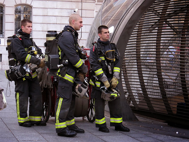Firefighters on stand-by outside the Saint-Lazare metro station, Cour de Rome, Paris
