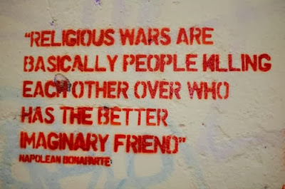 Funny graffiti sign - religious wars are basically people killing each other over who has the better imaginary friend - napoleon bonaparte