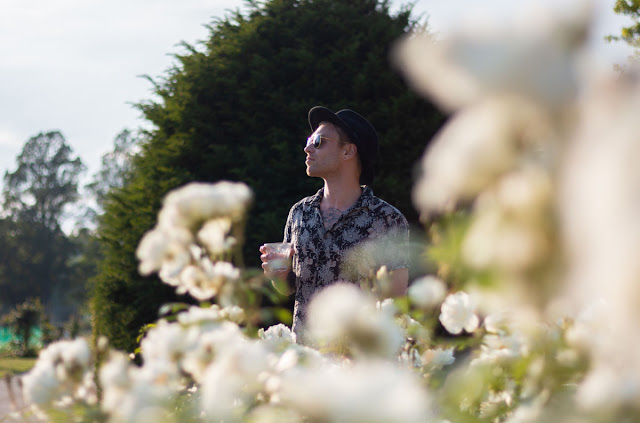 Image of a man in a garden with blurred foreground and background. Copyright Ashley Laurence - Time for Heroes Photography