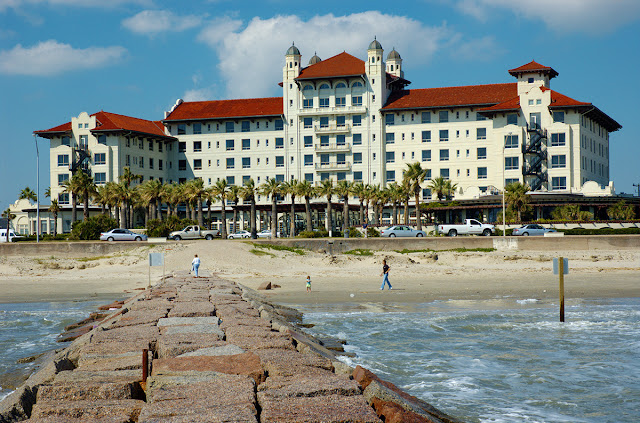 Discover Hotel Galvez & Spa a historic beachfront hotel in Galveston featuring elegant rooms, modern amenities, a full-service spa, and pool with swim-up bar.