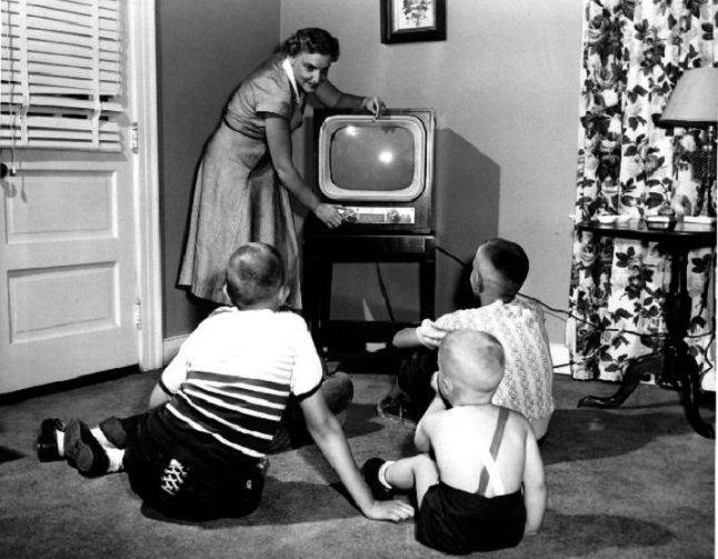 black kids watching tv. this time was black and white tvs. take a look at these lovely vintage photos to see children entertained by watching television in the past. kids tv i
