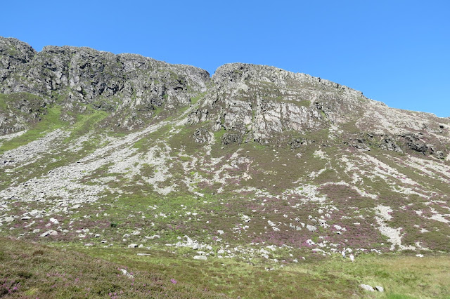 The north-eastern ridge of Moel Siabod against a blue sky.