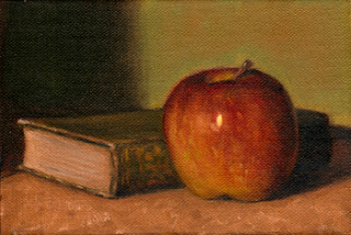 Oil painting of a red apple beside an old green-coloured linen-bound book.