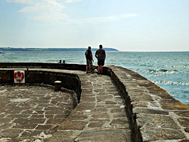 Fishing from Charlestown Harbour wall
