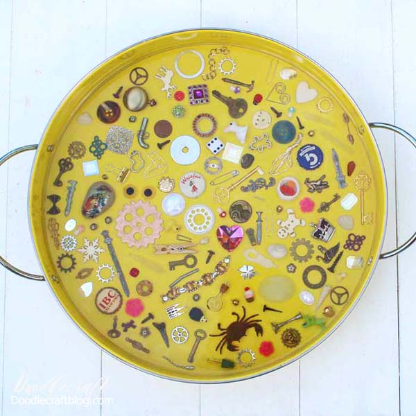 This I spy game resin serving tray filled with miniatures and trinkets is a fun DIY and would make a great gift! Fill the tray with little things from the junk drawer or little heirlooms that sit in a jewelry box collecting dust. With a thick layer of glossy resin, the trinkets stay in place and offer a smooth surface for using the tray for serving or a coffee table catch all.