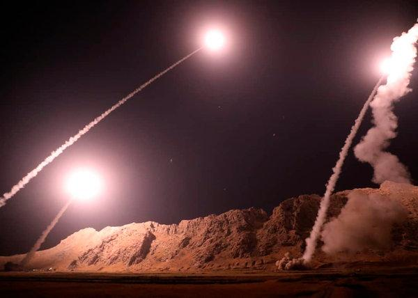 Image Attribute: A photo released by the Iranian Revolutionary Guards Corps (IRGC) launching six medium-range ballistic missiles from an undisclosed location in Kermanshah Province (Western Iran), towards Islamic State (IS) bases in Syria  October 1, 2018. Semiofficial Fars news agency in Iran said the missiles were of the Zulfikar and Qiam classes.