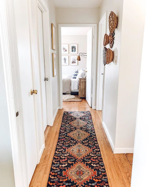 This one proves that you can make even a tiny hallway look pretty with some framed pictures and baskets.