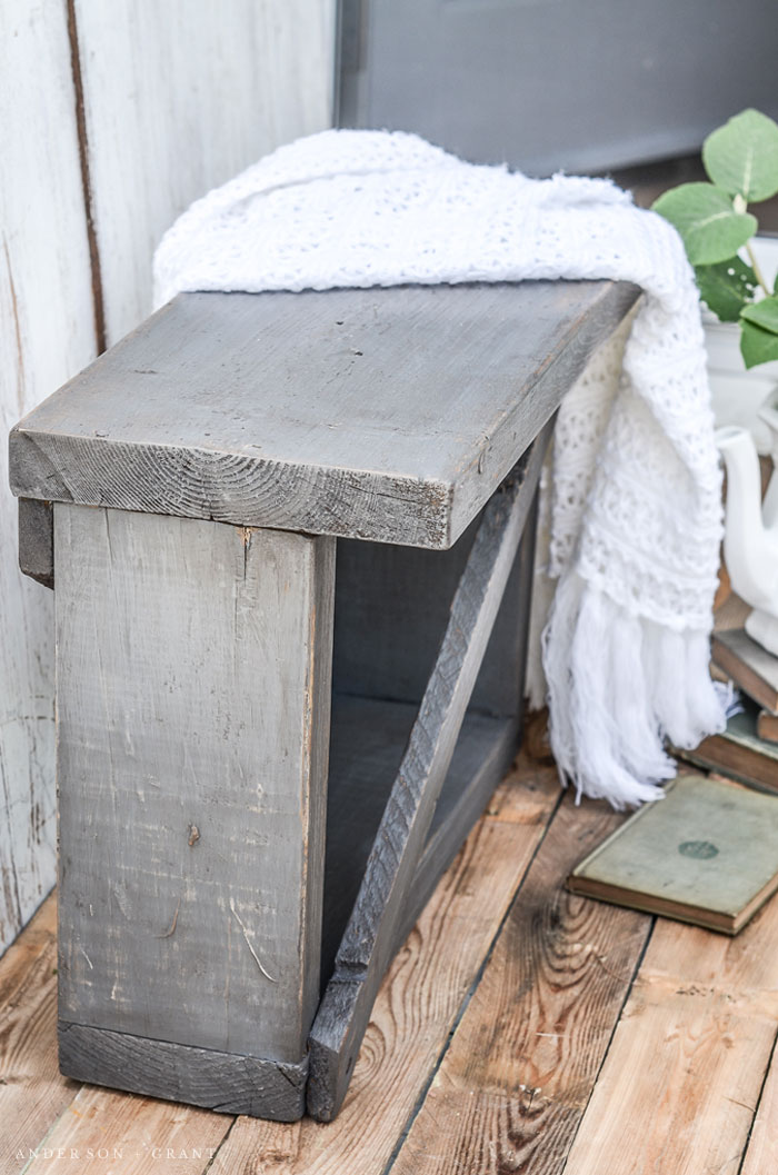 This small bench was constructed out of old boards and given lots of vintage charm with paint, wax, and a secret distressing technique.  #DIY #furnituremakeover #bench #farmhouse #farmhouseDIY