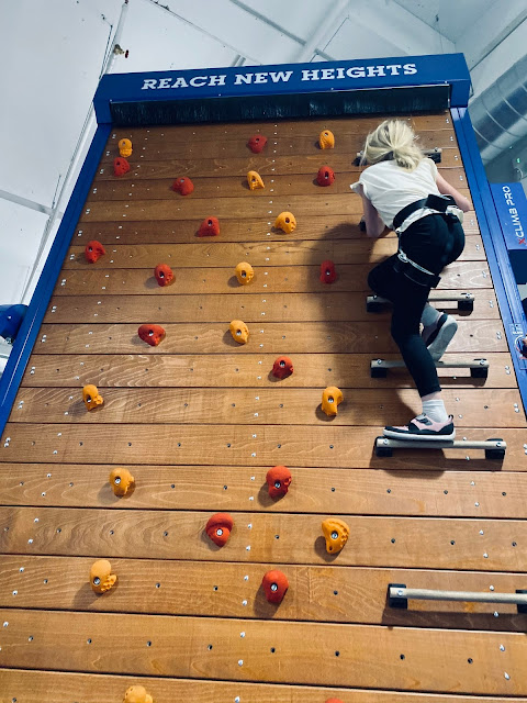 A climbing wall which rotates like a treadmill so you never reach the top