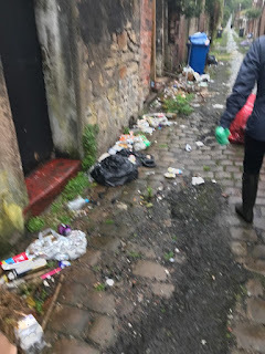 domestic rubbish in an alleyway