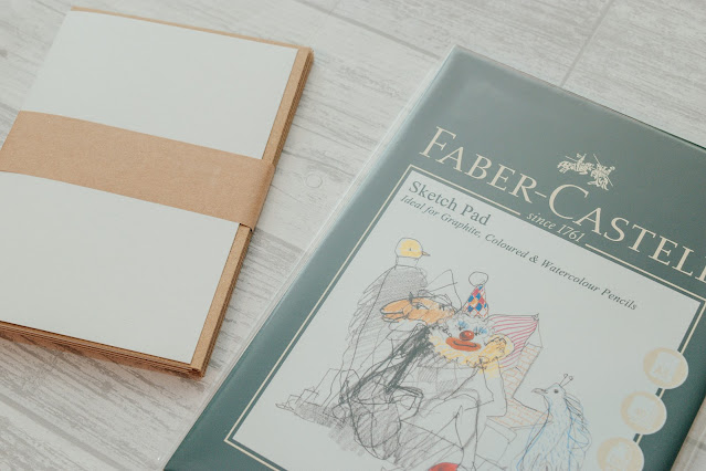 A sketchbook and a blank greeting card pack