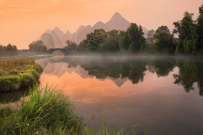 Dawn on Yulong river and Yulong Qiao