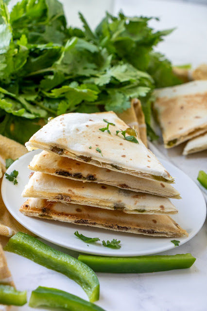 Philly Cheesesteak Quesadillas stack with bell pepper and parsley