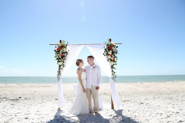 sanibel island wedding photographs with floral arch