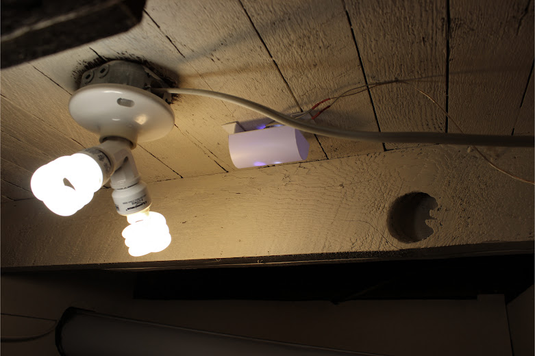 Styrene nighttime light diffuser box installed to the ceiling beside mini-spiral florescent bulbs