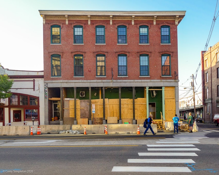 Portland, Maine USA June 2020 photo by Corey Templeton. Appears that 94 Commercial Street is getting a face lift. The building had a pretty noticeable tilt developing.