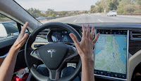 A Tesla Model S car equipped with autopilot in Palo Alto, California, on, Oct. 14, 2015. (Photograph Credit: David Paul Morris — Bloomberg via Getty Images) Click to Enlarge.