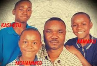 Kamaru With His Dad And Brothers