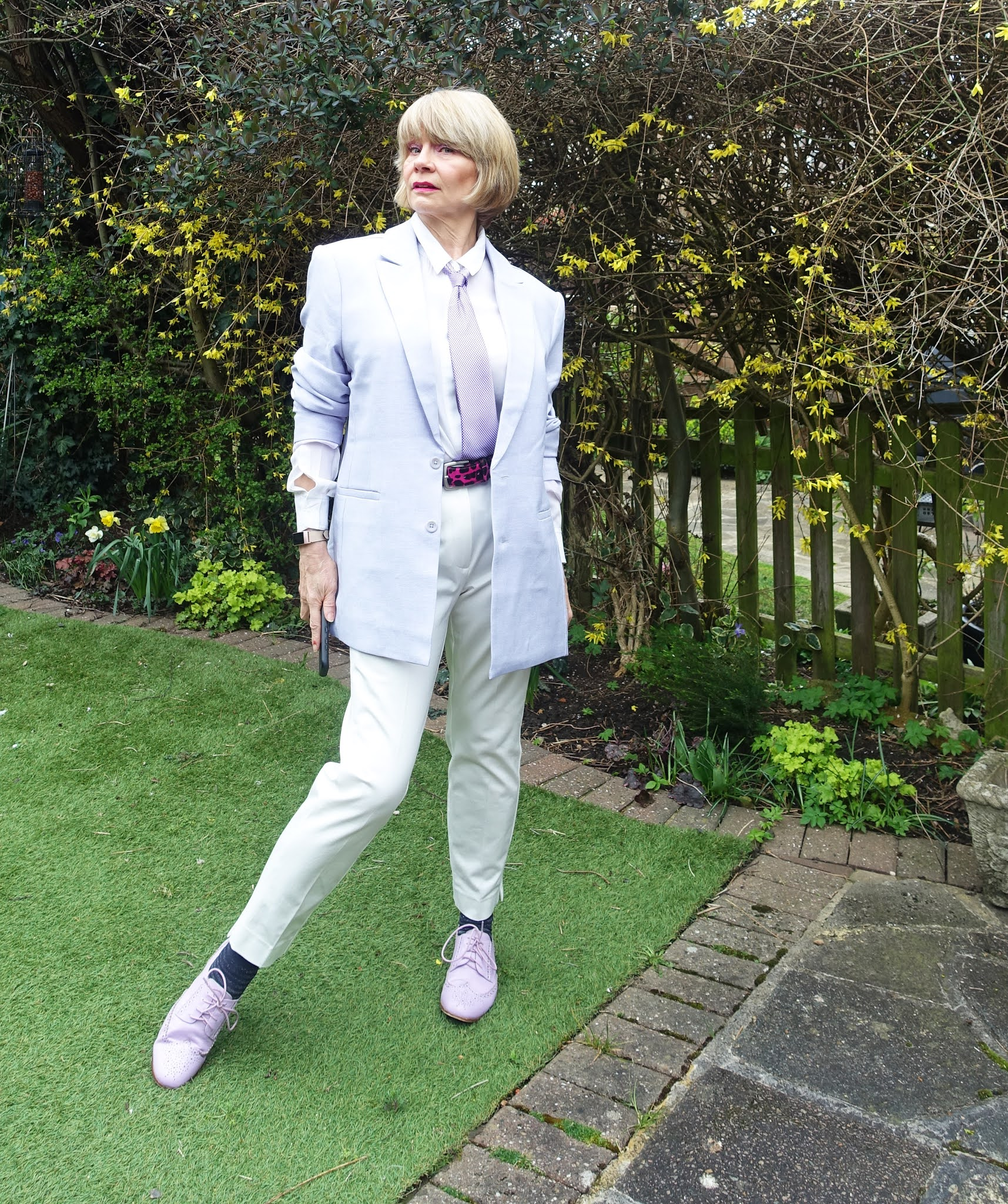 Is This Mutton blogger Gail Hanlon in unisex lilac jacket from Asos lilac brogues from the Bias Cut and white trousers from Marks and Spencer in an androgynous but feminine look