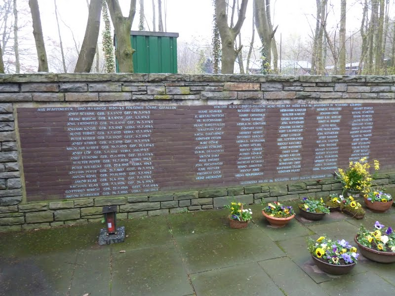 Memorial wall with the names of many fallen in combat
