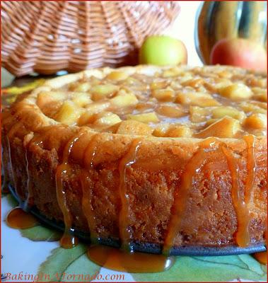 Celebrate apple season with an Apple Pie Cheesecake, apple pie flavored cheesecake with a caramel apple topping. | Recipe developed by www.BakingInATornado.com | #recipe #apple #RoshHashanah