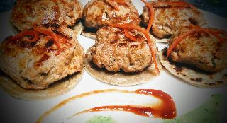 Serving garnished galouti kebab for galouti kebab recipe