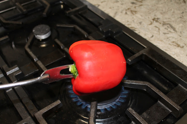 Roasting the red bell pepper for spicy marinated cheese.
